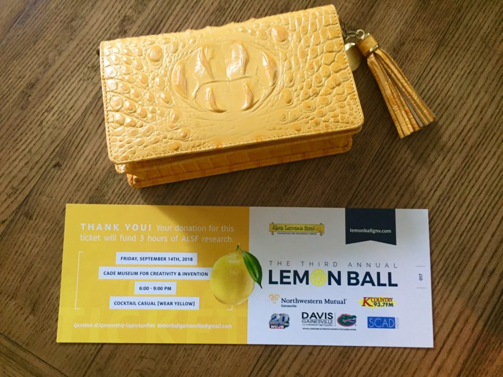 Yellow clutch and tickets for the Lemon Ball