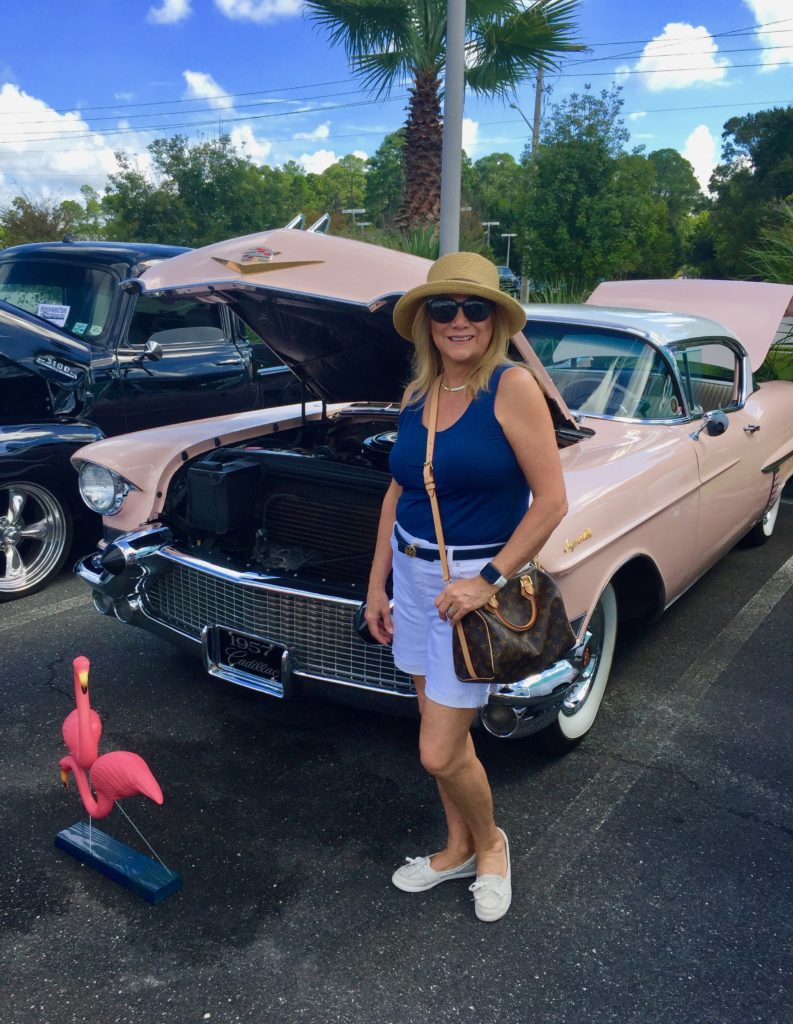 Lady and a pink Caddy
